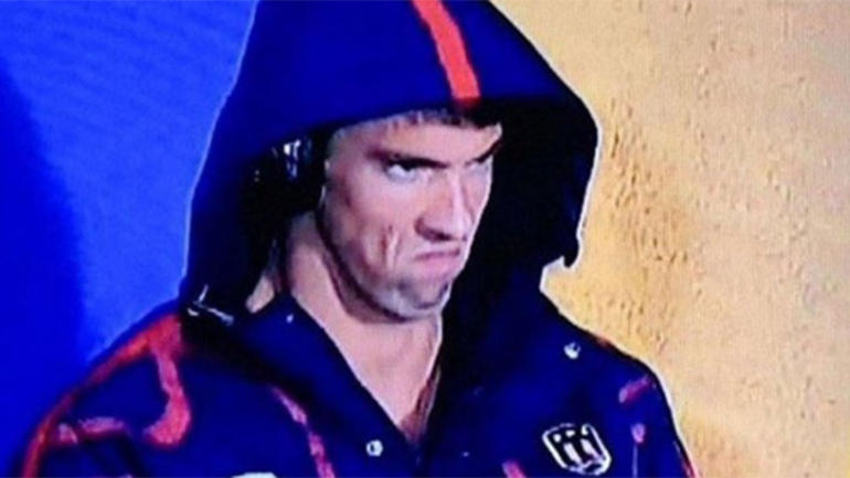 """The infamous """"Phelps Face"""". He's definitely getting fired up with his tunes."""