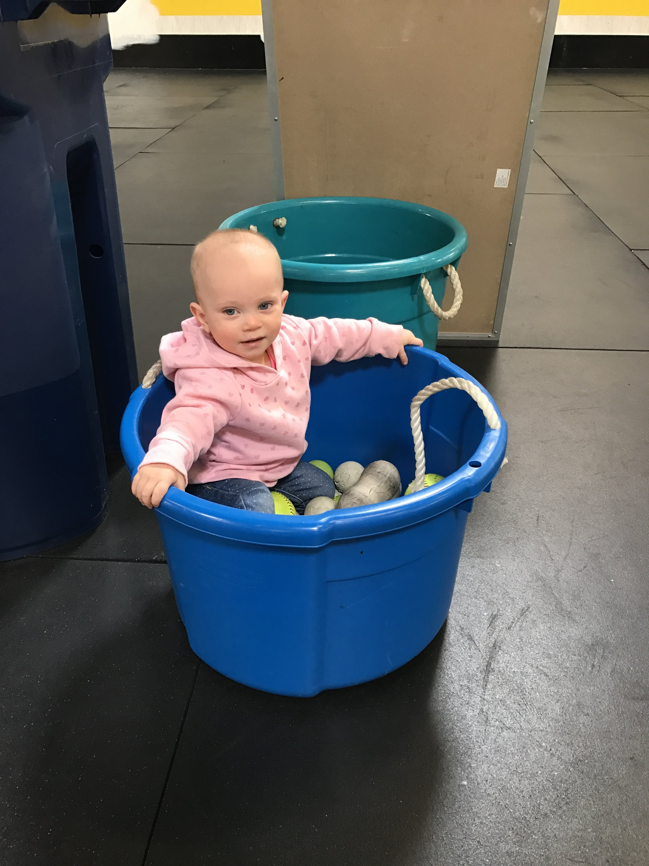 Go with the flow; just like this little girl. She went straight into the bucket of balls and smiled!