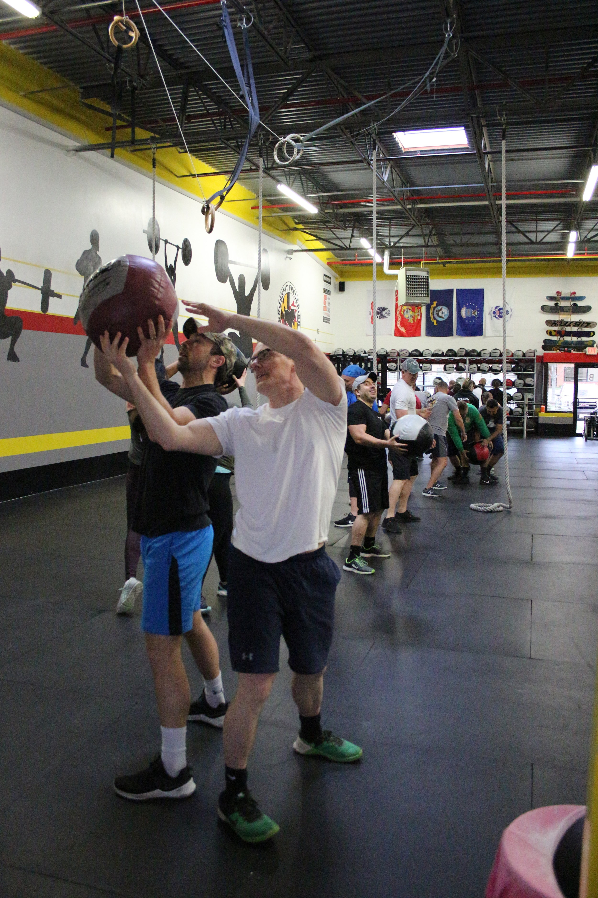 Dylan and Kevin passing off the medicine ball with a low high hand-off during warm-up.