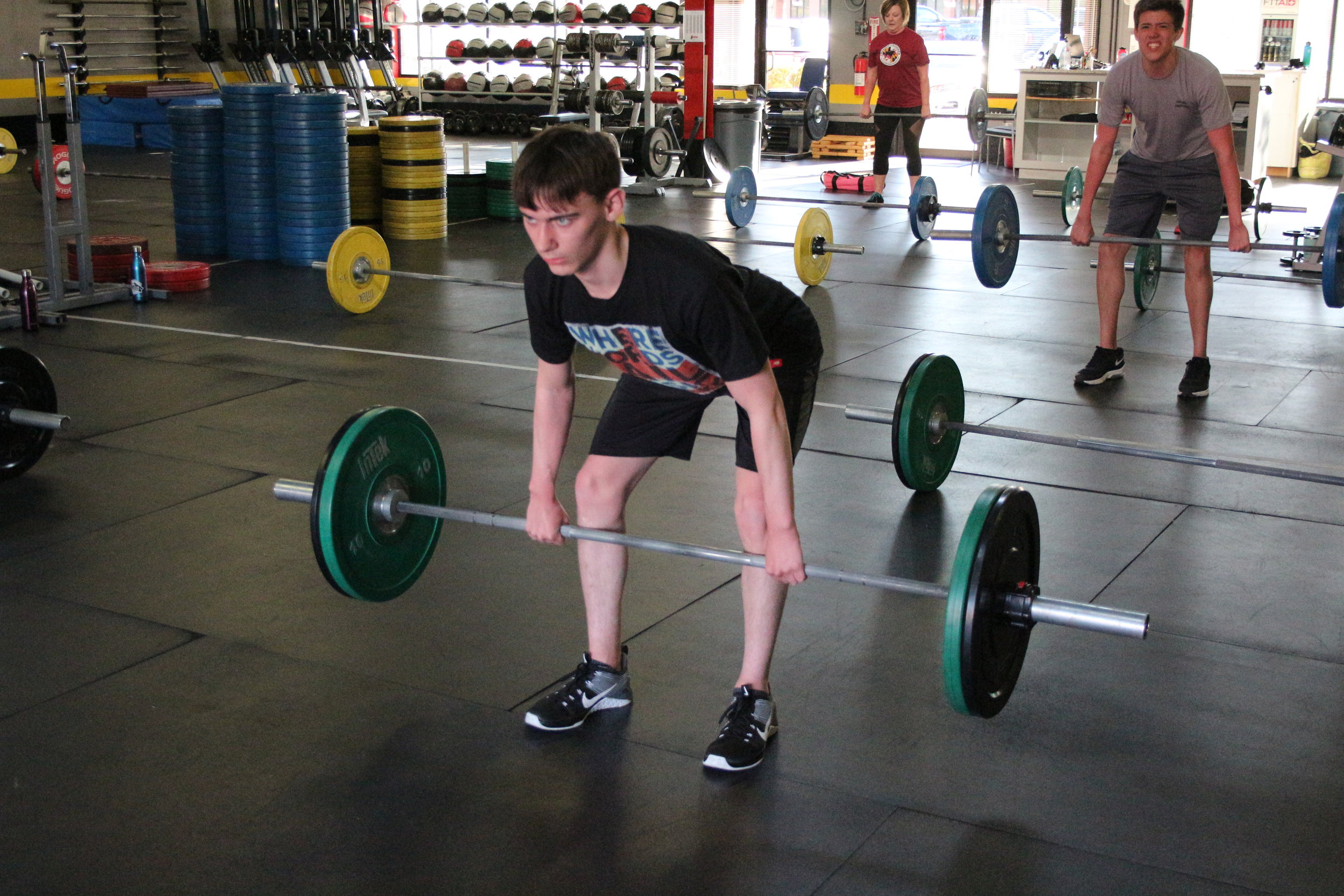 Mason, front, and Joey, back/right, a couple of our teens, improving their deadlift technique.