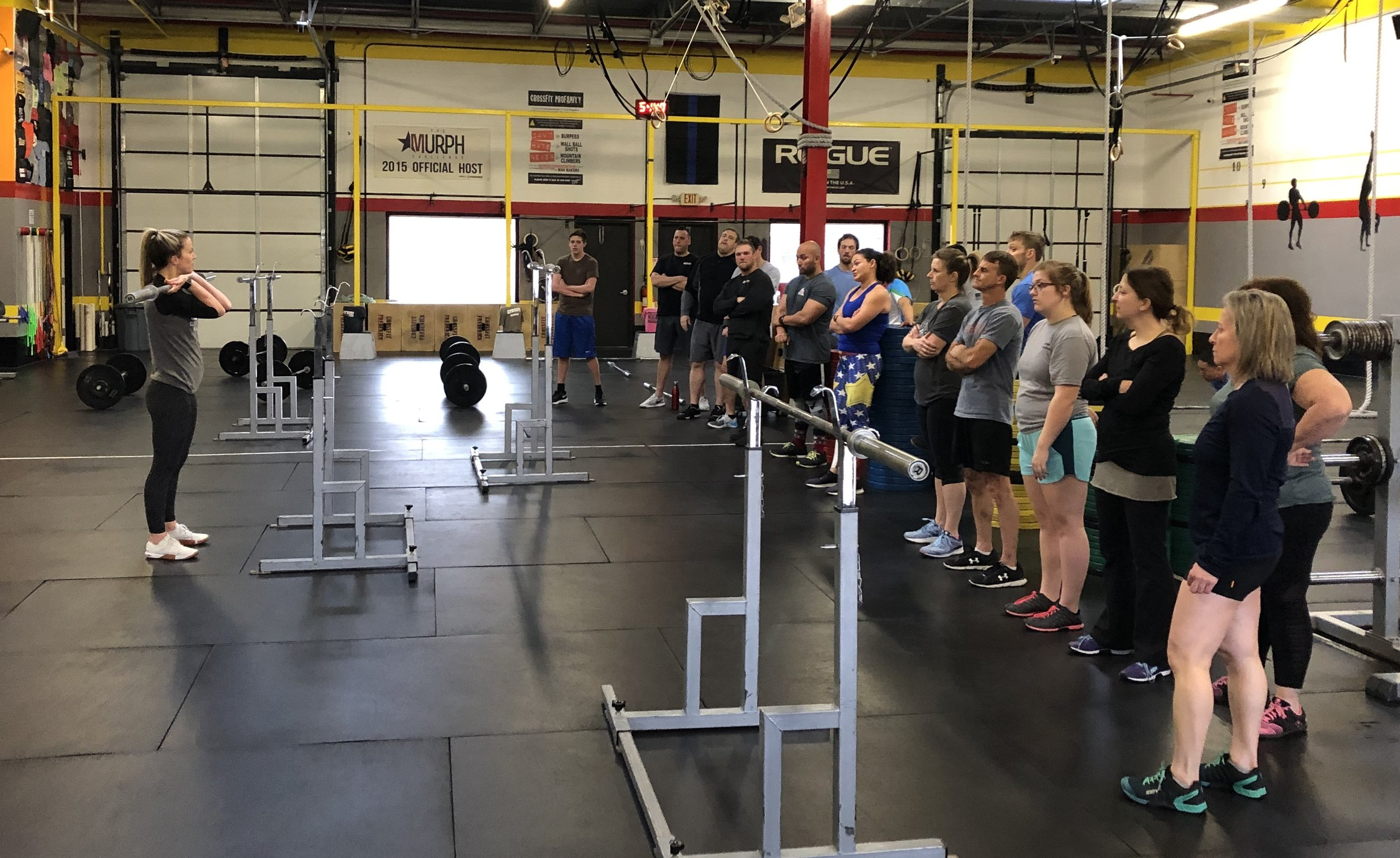 Detailed instruction is given by the Trainer prior to beginning any and all workouts at CrossFit Frederick. Here is Coach Hannah instructing on the Shoulder Press.