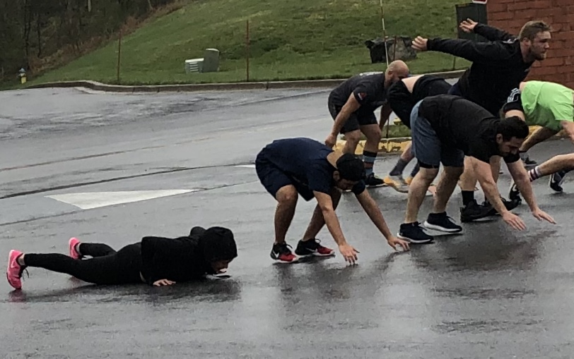 Burpee Broadjumps on asphalt teach an athlete to plant their hands and jump their feet back instead of walking their hands out in front of them. On days like this the asphalt is a comfortable temperature. :)