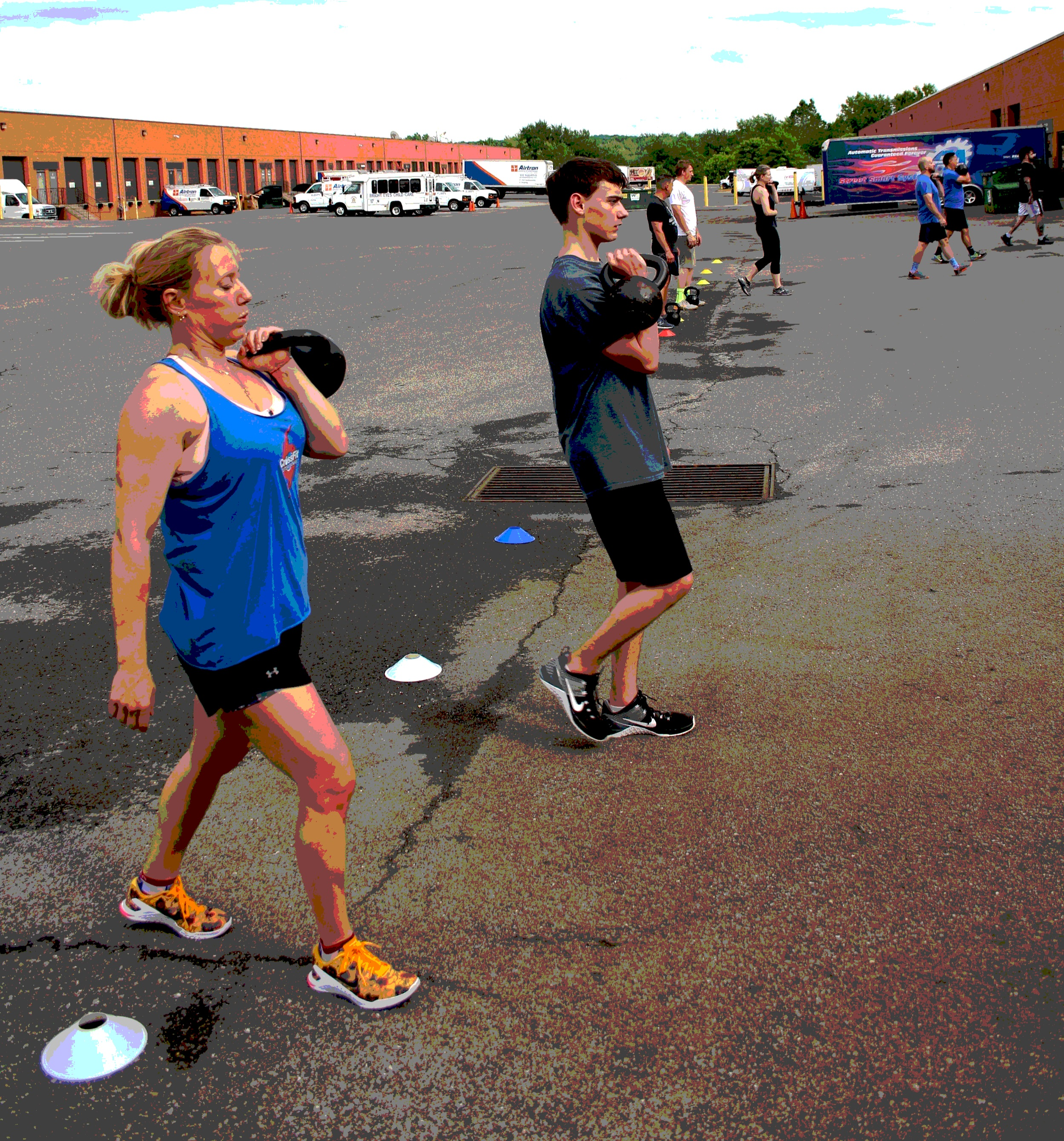 Pam Bator and her son, Mason. Kettlebell front rack carry for 10-meters.