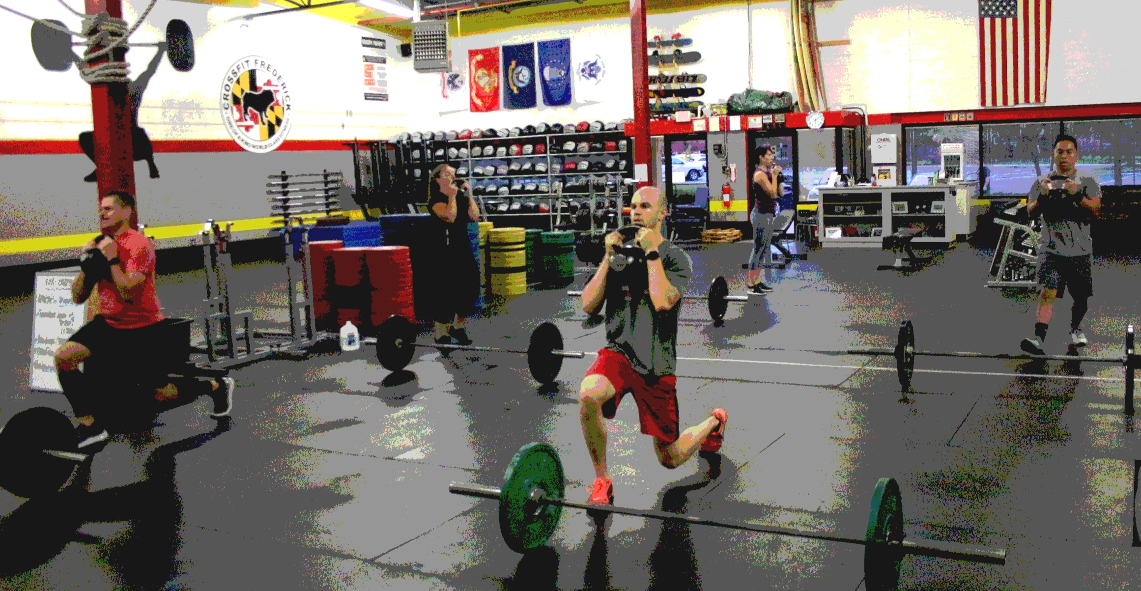 Left to right, Rob, Megan, Isaac, Karla, and Loc doing front rack stationary lunges with a Kettlebell.