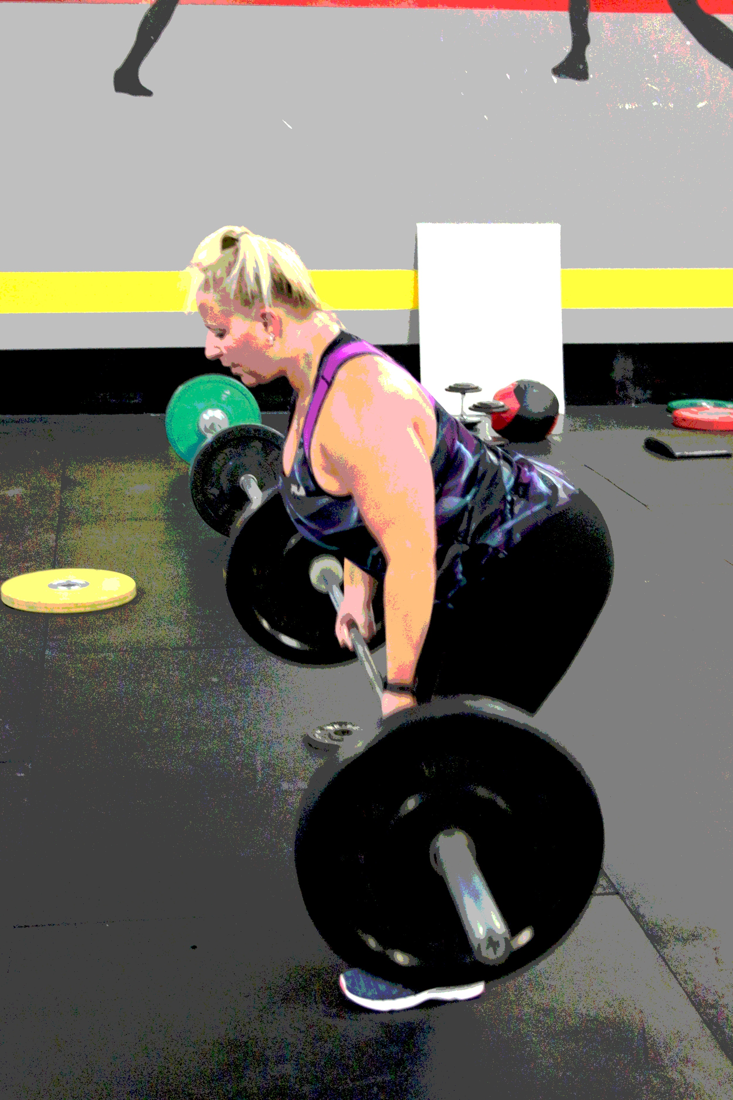 Nichole doing bent over rows.
