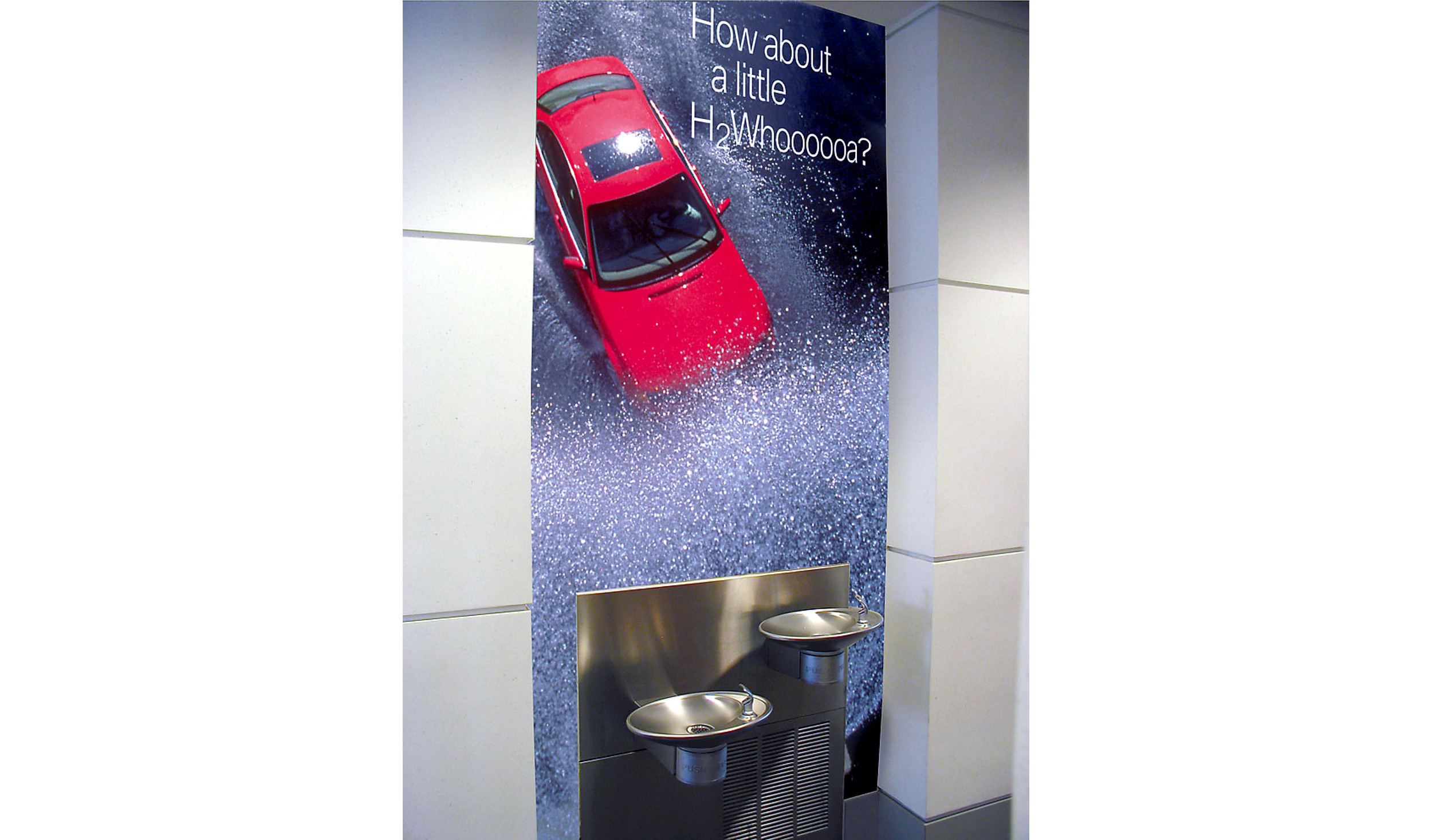 "BMW Water Fountain Graphics  This wall graphic was placed around a water fountain inside the BMW Performance Center and Driving School. The driving school track featured ""water walls"" as obstacles."