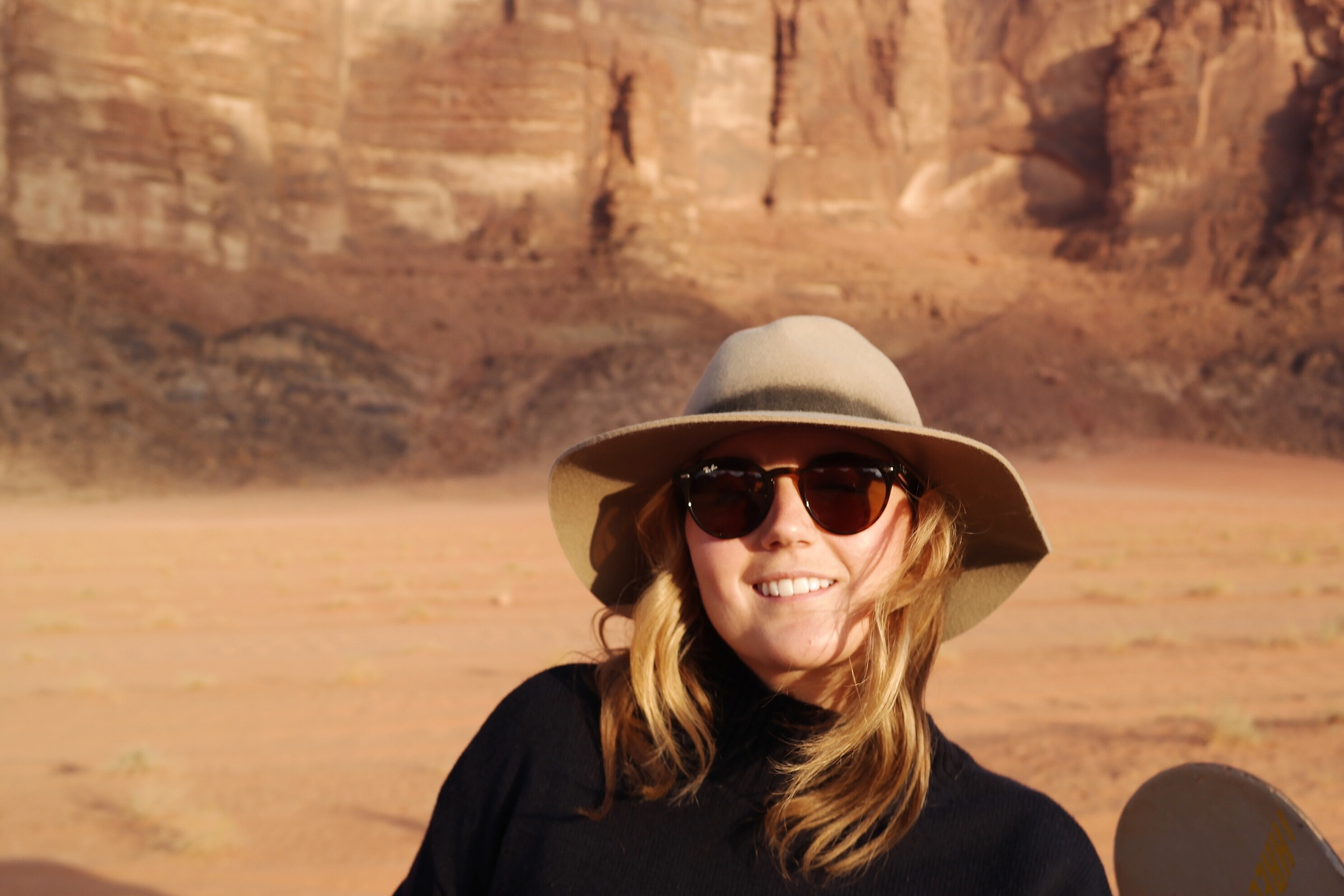 Here I am in my favorite hat riding around in the back of a truck in Wadi Rum, Jordan.  Fun Fact: The Martian with Matt Damon was filmed in Wadi Rum.