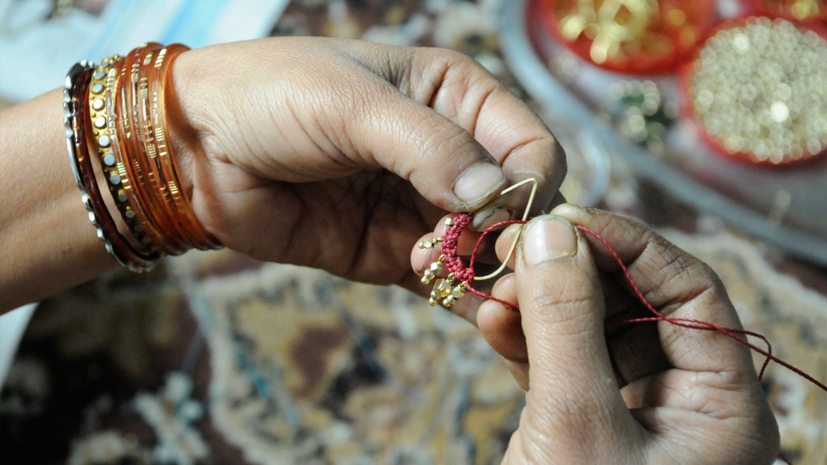 Artisan making earrings for The Didi Jewelry Project in India