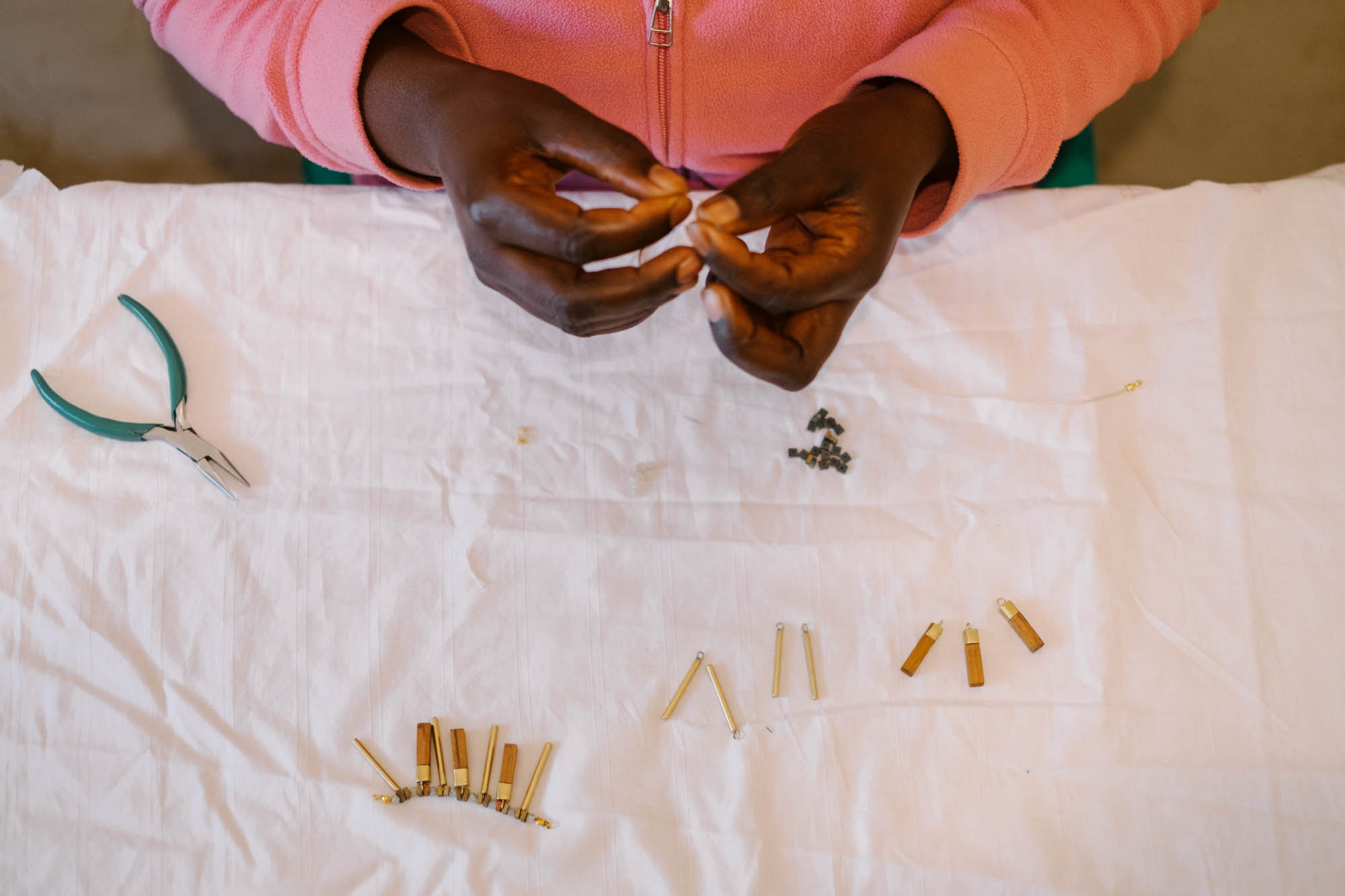 Artisan making jewelry for Jimani Collections in Kenya