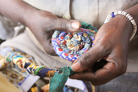 Artisan hand weaving a product for Grain of Rice Project in Kenya