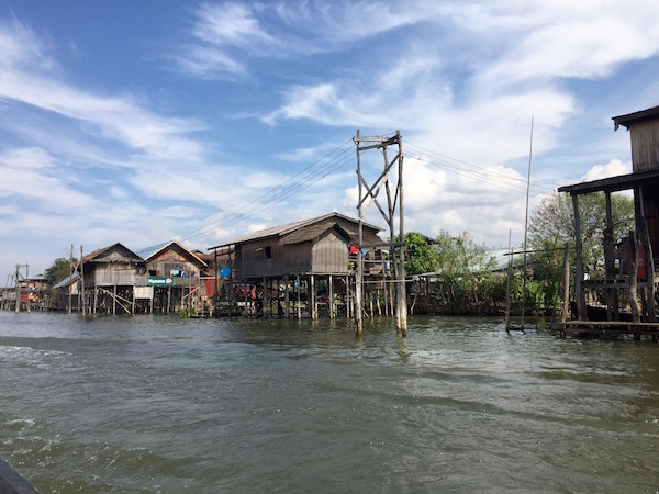 There are houses, businesses, restaurants and electricity - love those poles - on the lake. Including the  lotus weaving  house we visited.