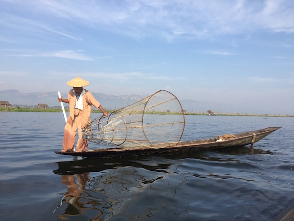 Fisherman with a traditional bamboo net