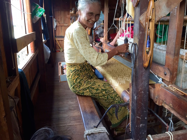 A lotus weaver on her loom. She was smiling at the 3-year old, not me. The kids paid their way with enhanced photo ops, free goods, and attention all through Myanmar.