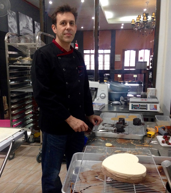 Alain the chef looking serious here about to put shiny chocolate icing on this beautiful (you guessed it) chocolate cake