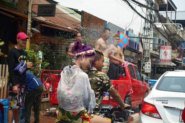 Motorbikes are fair game for water pelting