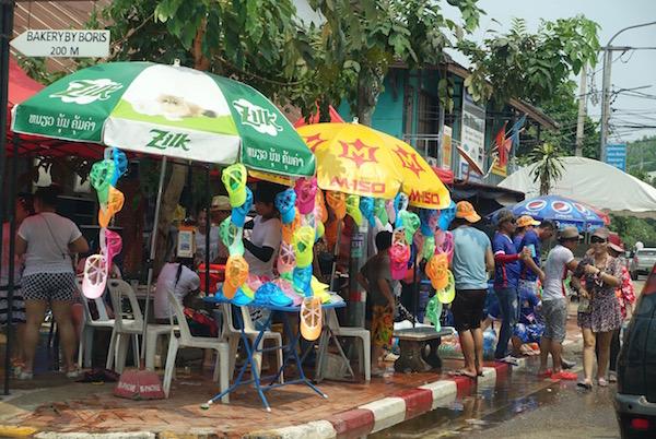 Plastic, waterproof  and  fluro caps also make a trendy Pi Mai fashion statement