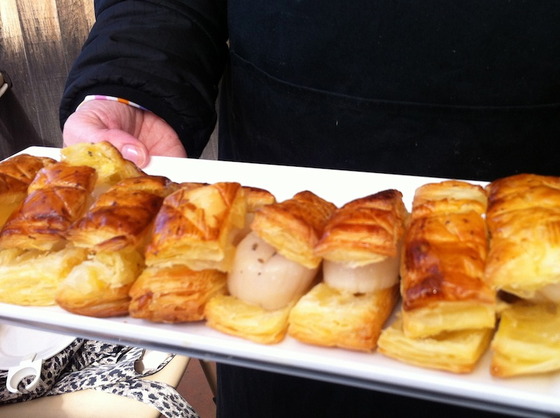 Scallops cooked in truffle butter and sandwiched between sheets of puff pastry