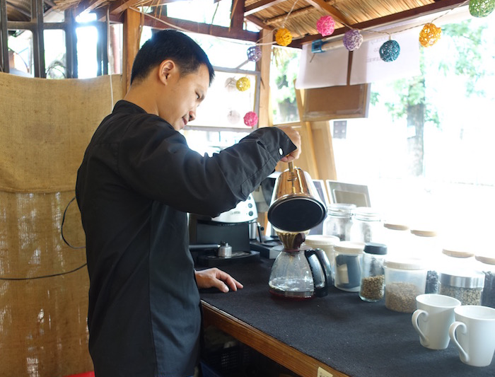 Pouring out a cup of filtered drip coffee