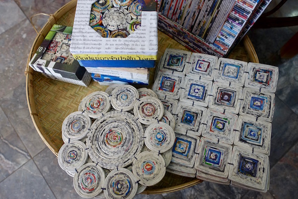 These recycled paper table mats and coasters are made by the  Lao Disabled Women's Centre