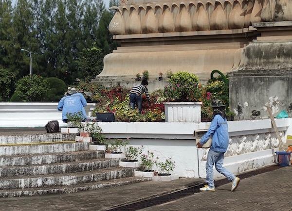 Gardeners plant new flowers around the steps of Patuxai, ASEAN Fever | Eat Drink Laos http://eatdrinklaos.com/blog/asean-fever