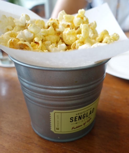 Get it while it's hot... hot and buttered that is... free popcorn and movie nostalgia at Senglao Cafe, Vientiane | Eat Drink Laos - http://eatdrinklaos.com/blog/vientiane-senglao-cafe - This tasty lunch restaurant has great decor, friendly service and delivers delicious food fast. If you're after lunch in Vientiane, Laos (or breakfast, coffee or dinner), try Asian fusion at Senglao cafe.