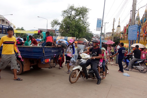Champasak province in southern Laos in October - cool, rainy and just beautiful. It's also Boat Racing Festival time - and everyone's invited. Traffic in Pakse, the capital of Champasak province | Eat Drink Laos http://eatdrinklaos.com/blog/southern-laos-champasak-boat-racing
