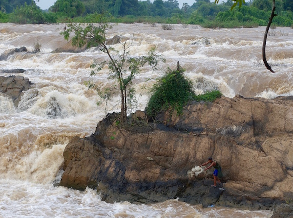 Don't try this at home - Lao local villages go fishing from one of southern Laos' biggest waterfalls - the 4,000 Islands of southern Laos | Eat Drink Laos http://eatdrinklaos.com/blog/southern-laos-4000-islands