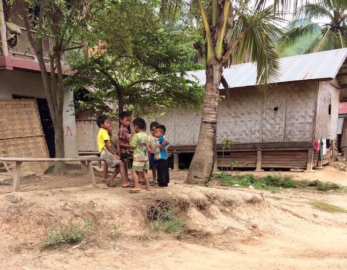 Village children play along the Mekong River in Laos - Northern Laos: Mekong River Cruise © Eat Drink Laos https://eatdrinklaos.com/blog/northern-laos-mekong-river-cruise