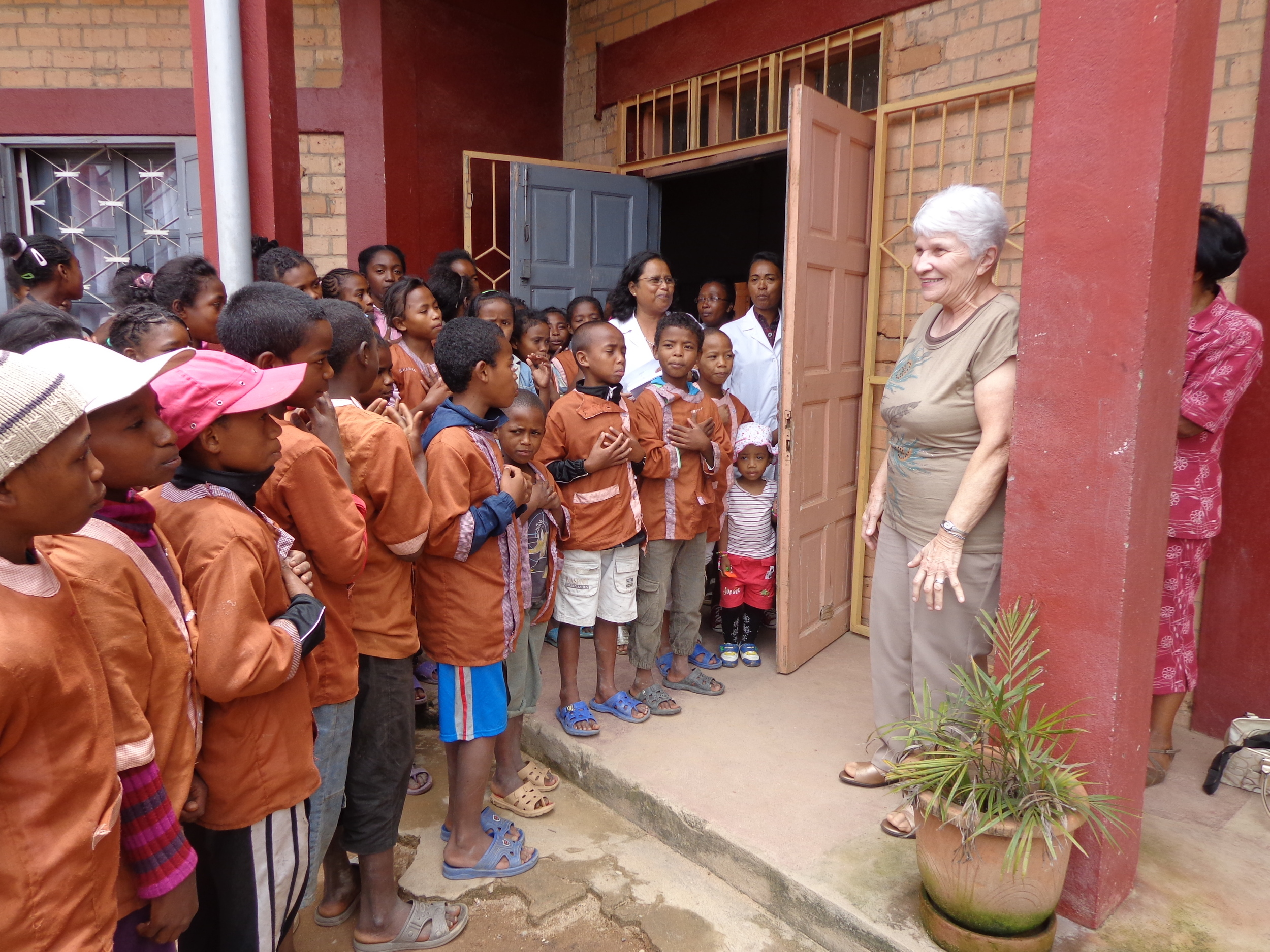 """AKANY TAFITA is an """"inner city centre for children and youth"""".  86 children come daily to this  elementary schoo l. When founder and missionary  Mary Sherwood  went to visit during her recent trip to Madagascar, the children welcomed her with singing and little welcome speeches!! Mary is from Carleton Place."""
