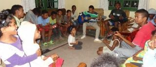"""Akany Famonjena   in Madagascar Orphanage for Children.  These are children of our Madagascar orphanage. There are currently  47 children who are cared for in every way by houseparents and a Directress. They are a """"family"""" and Famonjena is their """"Home"""". Presently, there are 3 children of pre-school age but all the others go to school outside our property. In general the children have become happy and healthy. In this photo you will see their happy faces as they sing and have fun together.""""See more pictures below."""