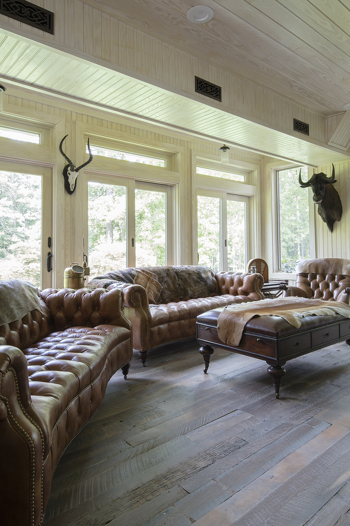 Photo: Alston Thompson Photography  The game room at a private residence in Manakin-Sabot, Virginia. Surface Architectural Supply provided the wood flooring and panelling for the bar.