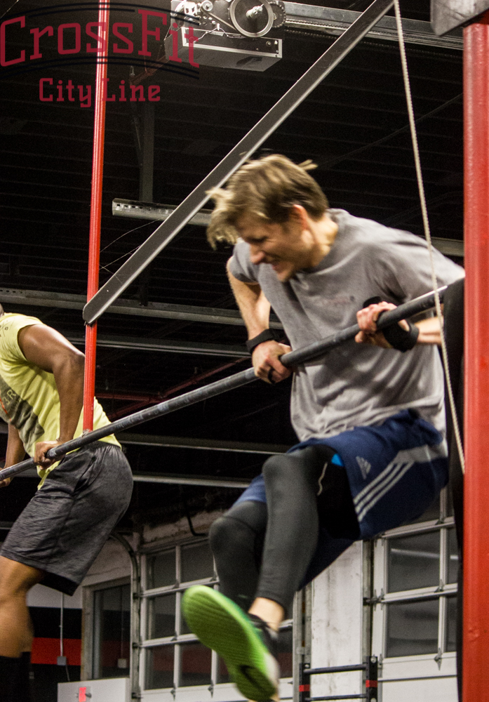 Brian fights through his bar muscle ups
