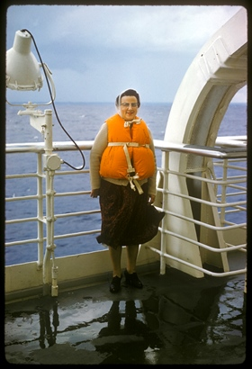 Woman on a ship with life vest