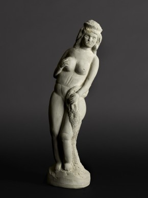 Carved stone sculpture of nude woman holding her breast