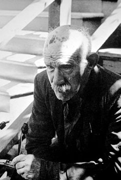Black and white photograph of artist Henry Darger