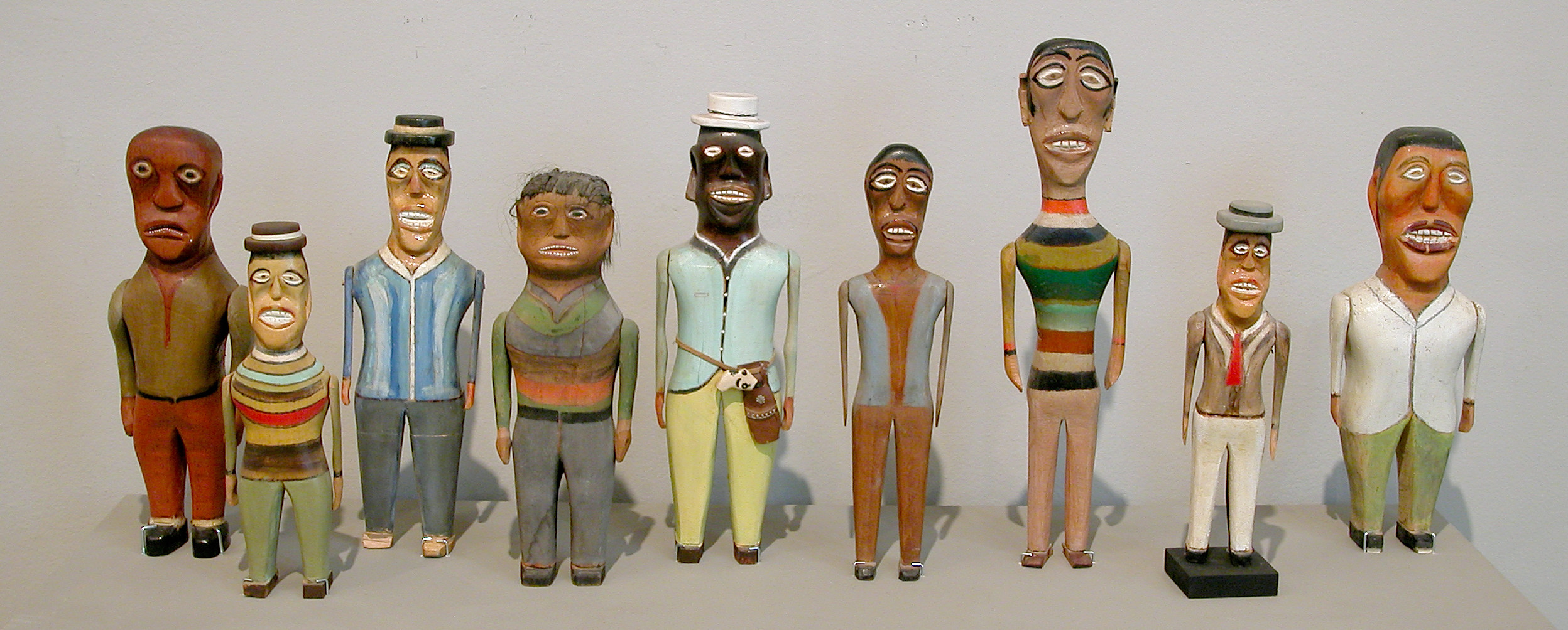 Nine wooden sculptures of figures carved by William Dawson