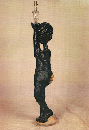 Dr. Charles Smith (American, b. 1940).  Untitled (Man with cornrows holding lamp) , n.d. Concrete, mixed media, and paint, 60 x 14 x 11 in. Intuit: The Center for Intuitive and Outsider Art, gift of Kohler Foundation, Inc., 2004.2.10