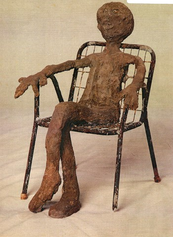 Dr. Charles Smith (American, b. 1940).  Untitled (Seated person) , ca. 1986-2002. Concrete, mixed media, and paint, 24 x 19 x 17 in. Intuit: The Center for Intuitive and Outsider Art, gift of Kohler Foundation, Inc., 2004.2.07