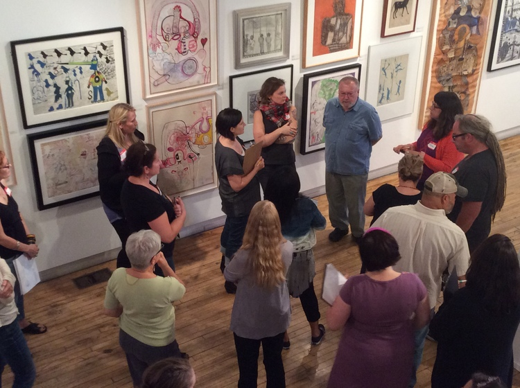 Teachers touring works of outsider art in gallery