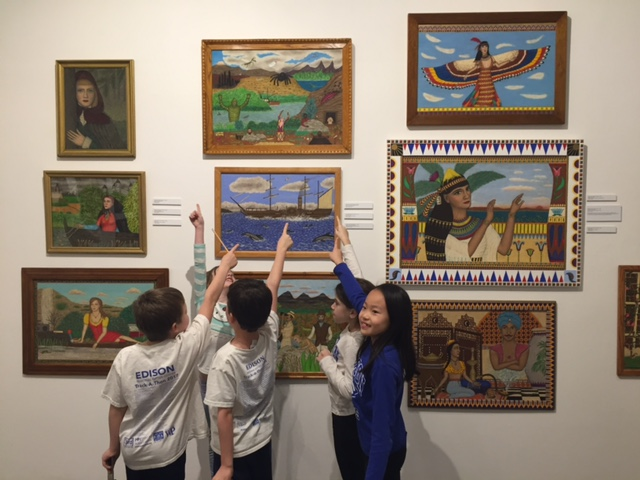Young students looking at outsider art