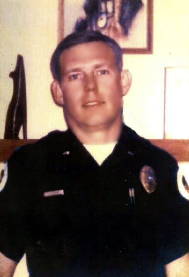 LieutenantDanny P. ElkinsYuma Police DepartmentEnd of Watch:Tuesday, July 4, 1995 - Lieutenant Danny Elkins and Sergeant Michael Crowe of the Arizona Department of Public Safety were shot and killed after they, and a third officer, went to their headquarters to check on paperwork in reference to missing evidence. All three officers were unarmed.While in the building the suspect shot and killed Sergeant Crowe and Lieutenant Elkins. The third officer escaped unharmed and summoned backup. A Yuma County deputy was charged with both murders. Sergeant Crowe and Lieutenant Elkins were the suspect's immediate supervisors in the Southwest Border Alliance.On April 30th, 1997, the suspect was convicted of two counts of first degree murder and sentenced to two consecutive life terms plus 40 years.Lieutenant Elkins was survived by his wife, daughter, and son.