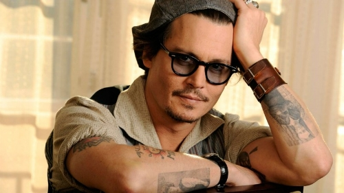 Johnny Depp famously shows off his ink.
