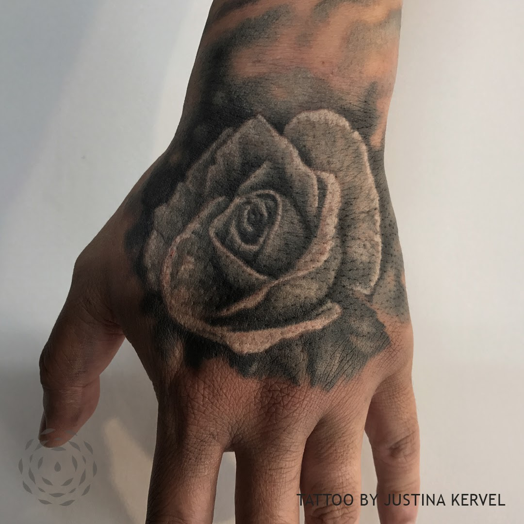 JUSTINA HAND ROSE.jpg