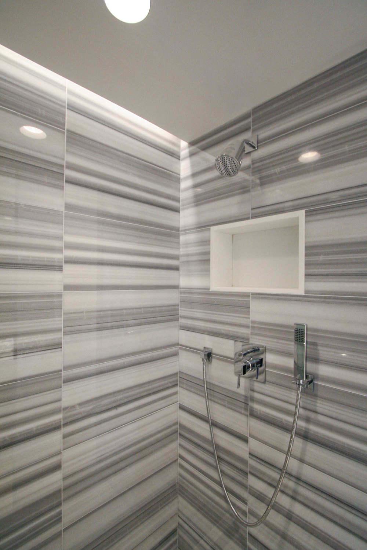 """Powder Room (with secret shower hidden behind a sliding panel) - """"Zebra"""" tile"""