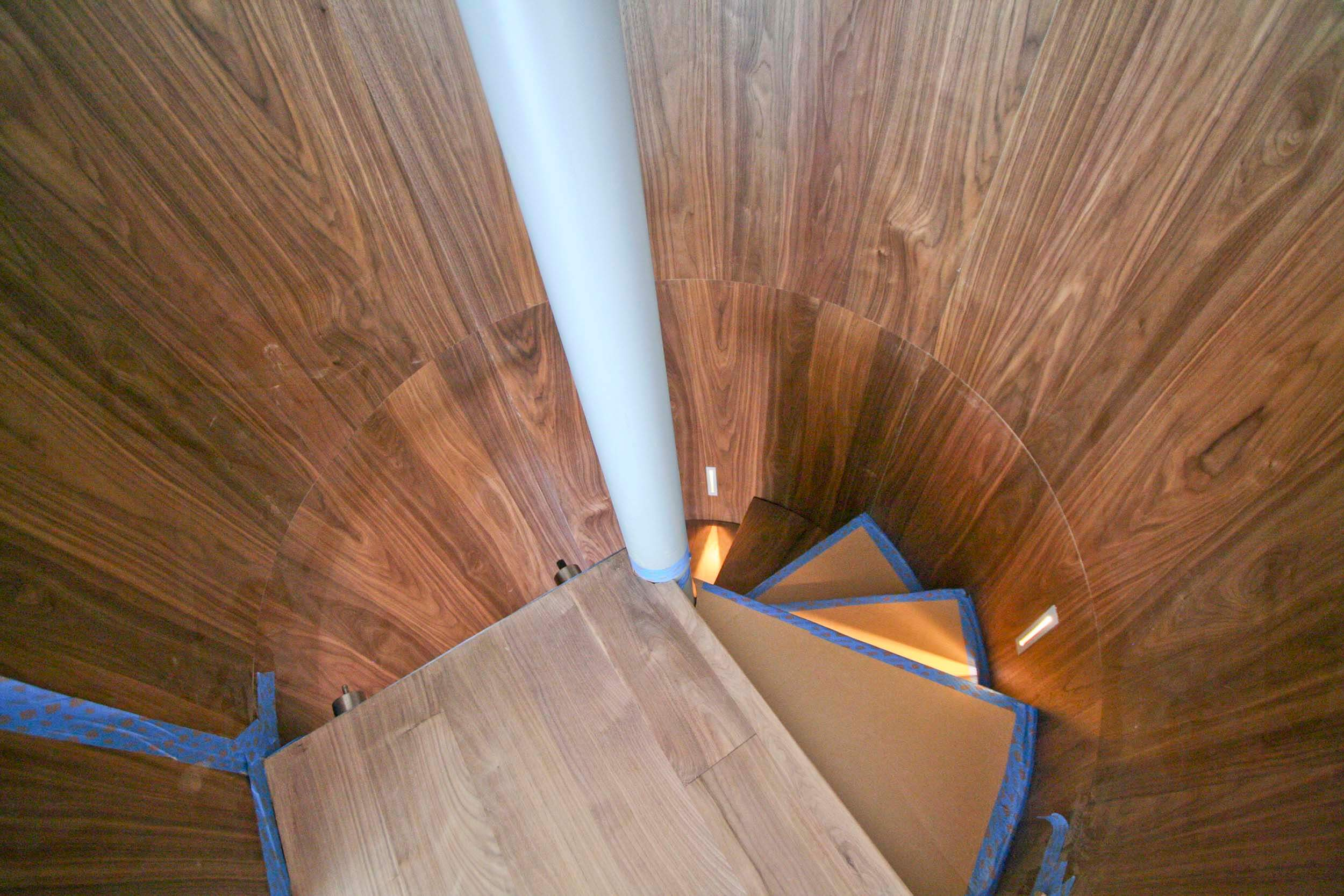 Walnut spiral stair  nearly complete -  Step lights create a nice accent