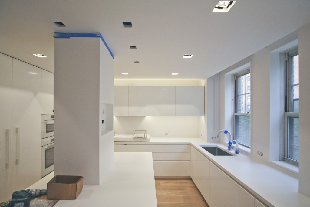 Kitchen   - a view of the kitchen island with an intersecting column and accent lighting above kitchen countertops.