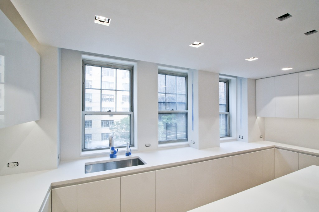Kitchen   - three windows line the new corian countertops to let in tons of natural light.