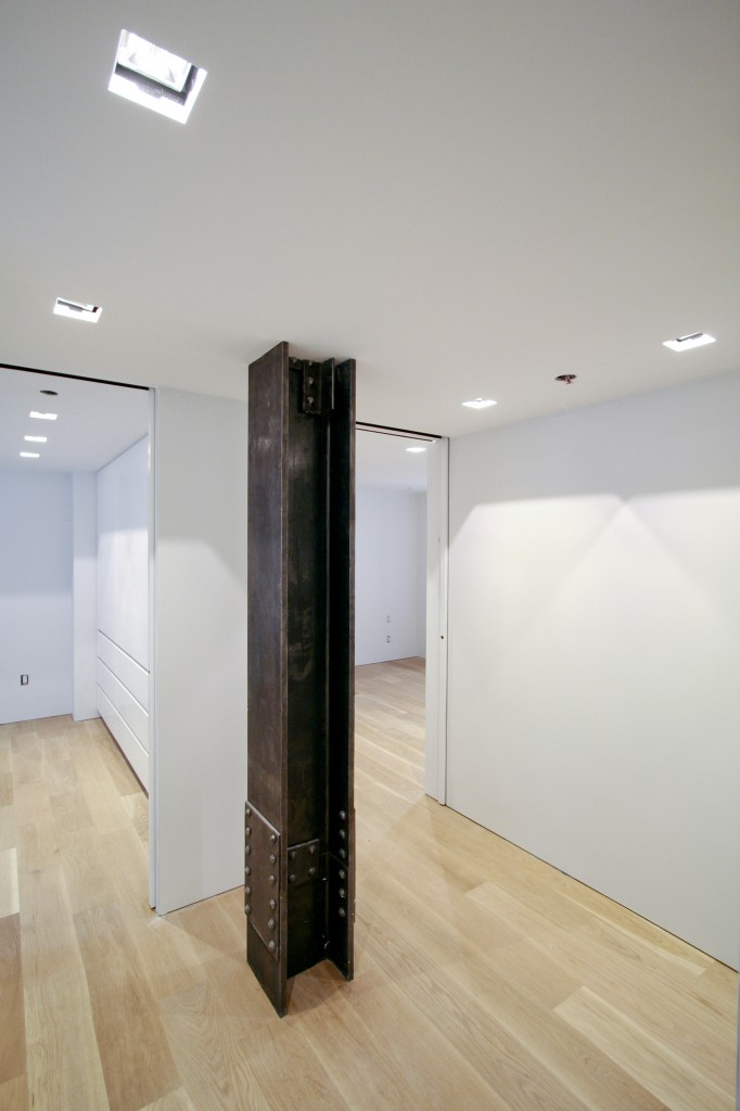 Hallway   - exposed steel column reveals the historic structure of the building.