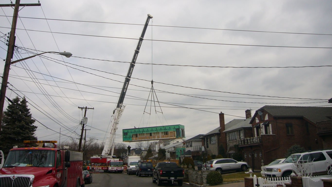 Side view of second box being lifted into place.