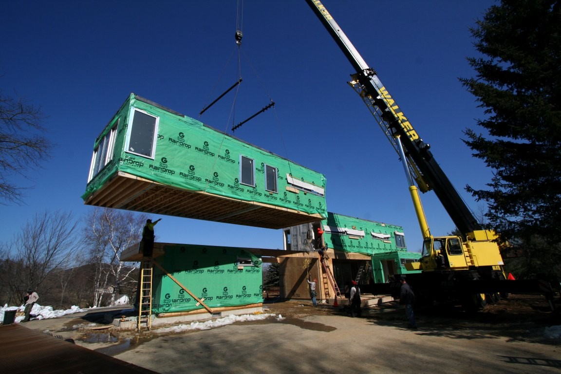 Setting 2nd floor module in place